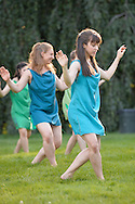 Old Westbury, New York, U.S. - June 21, 2014 - Lori Belilove & The Isadora Duncan Dance Company performs the Skye Dance dance in tunics of blues and greens during the Midsummer Night event at the Long Island Gold Coast estate of Old Westbury Gardens on the first day of summer, the summer solstice.