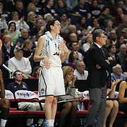 Breanna Stewart, UConn, on the bench as UConn coach Geno Auriemma, (right), watches the team during the UConn Vs DePaul, NCAA Women's College basketball game at Webster Bank Arena, Bridgeport, Connecticut, USA. 19th December 2014