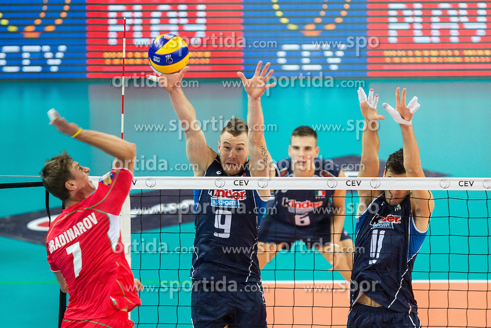 Miroslav Gradinarov of Bulgaria vs Ivan Zaytsev of Italy and Simone Buti of Italy during volleyball match between National teams of Bulgaria and Italy at Third place match of 2015 CEV Volleyball European Championship - Men, on October 18, 2015 in Arena Armeec, Sofia, Bulgaria. Photo by Vid Ponikvar / Sportida