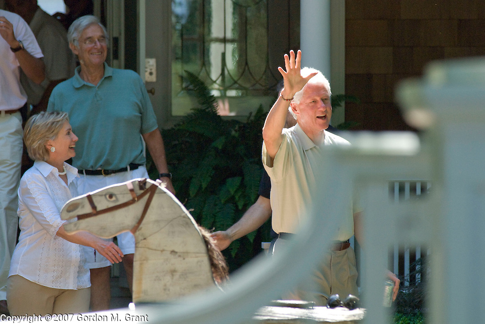 East Hampton, NY - 8/5/07 -  Senator Hillary Clinton and former President Bill Clinton leave breakfast fundraiser at home of Alan Patricof in East Hampton, NY August 5, 2007. Patricof is in green shirt.    (Photo by Gordon M. Grant )