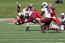 02 October 2010:  Ben Ericksen leaps for extra yardage on a 2 yard gain during an NCAA football game where the Southern Illinois Salukis beat the Illinois State Redbirds 3817 at Hancock Stadium in Normal Illinois.