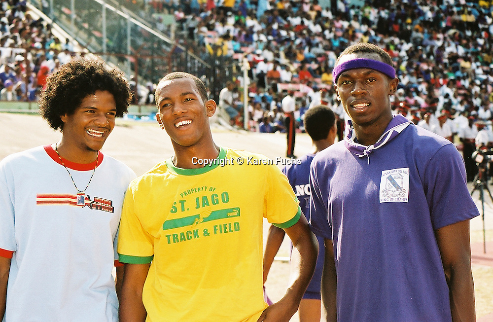 Usain Bolt with Germaine Gonzales and friend at Boys and Girls Highschool Champs in Kingston Jamaica March'05