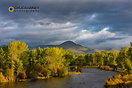 Dramatic stormy sunrise light strikes the Big Hole River near Melrose, Montana, USA