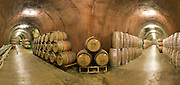 Barrels of estate grown cabernet sauvignon wine, and new barrels in underground caves at famous Chateau Montelena winery in Calistoga, Napa Valley, California