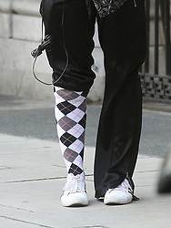 ©London News Pictures. 15/01/2011 .Picture Credit Should read Neil Hall/London News Pictures.Madonna directs her new period film W.E. starring Abbie Cornish about the abdication of King Edward in London on 08/08/2010 pictured is her latest style with one trouser leg rolled up