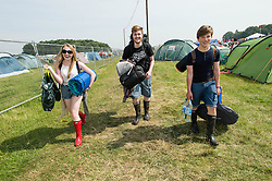 © Licensed to London News Pictures. 18/07/2014. Southwold, UK.  Festival goers arrive with their bags & tents at Latitude Festival 2014 Day 1. Today is expected to be the hottest day of the year with temperatures forecast to reach 32 degrees centigrade.   Latitude is an British annual music festival.  Photo credit : Richard Isaac/LNP