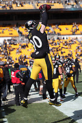 Pittsburgh Steelers rookie outside linebacker T.J. Watt (90) leaps and catches a pass while warming up on the sideline before the NFL 2018 AFC Divisional playoff football game against the Jacksonville Jaguars, Sunday, Jan. 14, 2018 in Pittsburgh. The Jaguars won the game 45-42. (©Paul Anthony Spinelli)