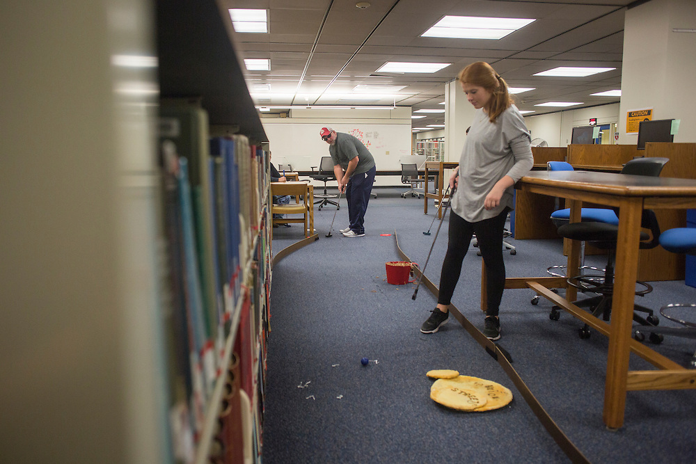 Kate Newberry, a freshman, right, plays mini golf with her dad Tim Newberry, of Chillicothe, Ohio in Alden Library during Dad's Weekend on November 5, 2016.