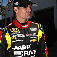 NASCAR Sprint Cup driver Jeff Gordon is seen in the garage area, during a NASCAR Daytona 500 practice session at Daytona International Speedway on Wednesday, February 20, 2013 in Daytona Beach, Florida.  (AP Photo/Alex Menendez)