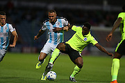 Brighton midfielder, winger, Kazenga LuaLua and Huddersfield Town defender Joel Lynch during the Sky Bet Championship match between Huddersfield Town and Brighton and Hove Albion at the John Smiths Stadium, Huddersfield, England on 18 August 2015.