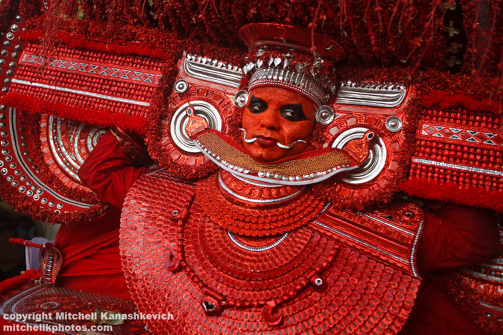 Theyyam Performance, Kannur District, Kerala India. .It is believed that while performing, the artist is possessed by a divine spirit and becomes a God - or Theyyam in the local language. In Hinduism there are literally millions of Gods, both good and evil and The four hundred existing variations of Theyyam performances are dedicated to just some of them.