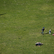 April 1, 2017 - Lisbon, Portugal : Birds-eye-view of two children playing soccer on the grass in the Jardim da Torre Belem in Lisbon as a couple cuddles nearby. CREDIT: Karsten Moran / Redux Pictures