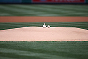 ANAHEIM, CA - MAY 4:  Closeup photo of a rosin bag and a baseball on the pitcher's mound before the Los Angeles Angels of Anaheim game against the Texas Rangers at Angel Stadium on Sunday, May 4, 2014 in Anaheim, California. The Rangers won the game 14-3. (Photo by Paul Spinelli/MLB Photos via Getty Images)