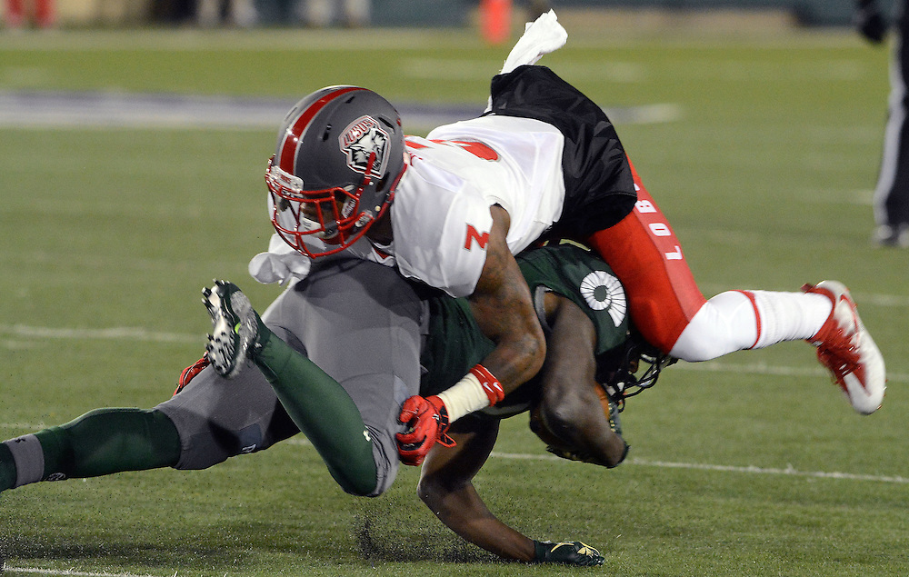 jt111916e/sports/jim thompson/UNM's # 3 Nias Martin makes the tackle on CSU's # 1 Dalyn Dawkins  in their game Saturday night in Fort Collins,CO. Thursday Nov. 17, 2016. (Jim Thompson/Albuquerque Journal)