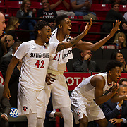 10 November 2017:  The San Diego State Aztecs men's basketball team opens up the season against San Diego Christian. San Diego State Aztecs guard Jeremy Hemsley (42), forward Malik Pope (21) and Devin Watson (0) celebrate late in the second half against the San Diego Christian Hawks. The Aztecs beat the Hawks 91-52 at the half.<br /> www.sdsuaztecphotos.com
