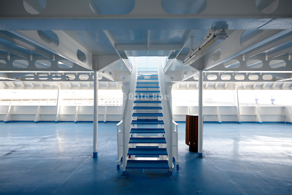 stairs to upper decks on large passenger ferry ship