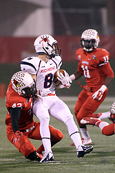 11 December 2015:  Soniel Estime(42) wraps up a run by Porter Abell. NCAA FCS Quarter Final Football Playoff game between Richmond Spiders and Illinois State Redbirds at Hancock Stadium in Normal IL (Photo by Alan Look)