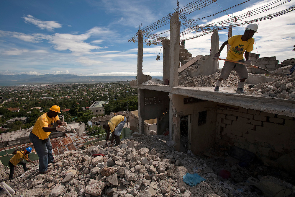 Workers clear the destruction in a program call Cash For Work in a neighborhood  in Port-au-Prince, Haiti on July 15, 2010. <br /> Six month after a catastrophic earthquake measuring 7.3 on the Richter scale hit Haiti on January 13, 2010, killing an estimated 230,000 people, injuring an estimated 300,000 and making homeless an estimated 1,000,000.
