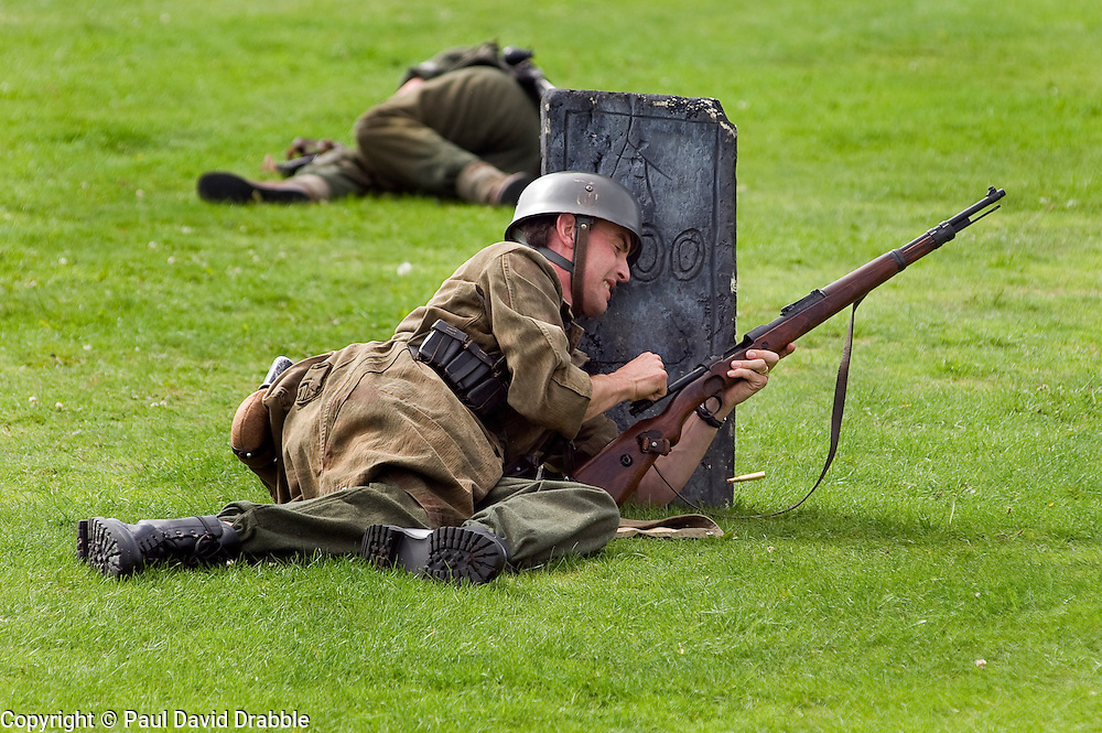 A reenactor portrays a German Paratrooper (Fallschrimjager) during a battle re-anactment at the The first Annual Lytham 1940s Weekend held to celebrate the 70th anniversary of the battle of Britain and raise funds for a new Fighter and Bomber Command Memorial to be erected in Lytham. 21 August 2010 Images © Paul David Drabble..