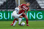 Marvin Johnson (21) of Middlesbrough battles for possession with Yan Dhanda (21) of Swansea City during the EFL Sky Bet Championship match between Swansea City and Middlesbrough at the Liberty Stadium, Swansea, Wales on 14 December 2019.