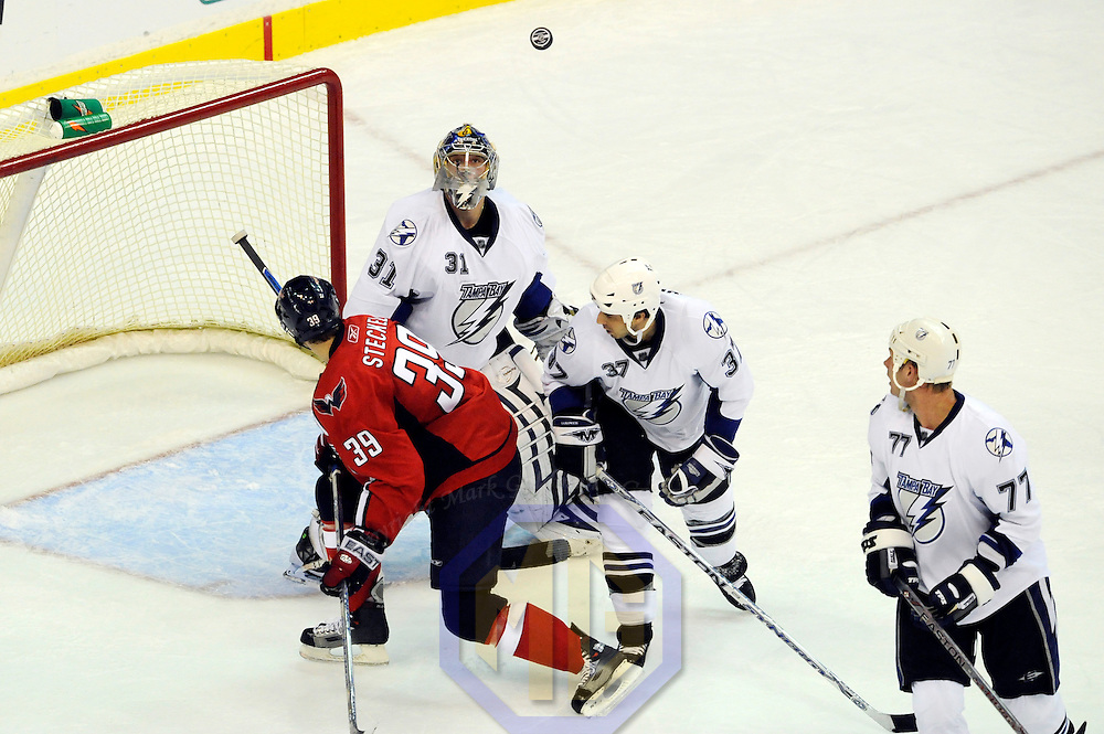 26 December 2007:  Washington Capitals center Dave Steckel (39) has his shot bounce high in the air in the third period as Tampa Bay Lightning goalie Karri Ramo (31) follows the flight of the puck at the Verizon Center in Washington, D.C.  The Capitals defeated the Lightning 3-2.