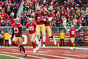 San Francisco 49ers defensive end Cassius Marsh (54) and San Francisco 49ers linebacker Jimmie Gilbert (47) celebrate during a game against the Jacksonville Jaguars at Levi's Stadium in Santa Clara, Calif., on December 24, 2017. (Stan Olszewski/Special to S.F. Examiner)