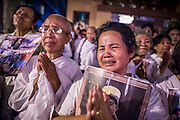 "04 FEBRUARY 2013 - PHNOM PENH, CAMBODIA: Cambodians cry out at the cremation of their former King Norodom Sihanouk during the King-Father's cremation service in Phnom Penh. Norodom Sihanouk (31 October 1922 - 15 October 2012) was the King of Cambodia from 1941 to 1955 and again from 1993 to 2004. He was the effective ruler of Cambodia from 1953 to 1970. After his second abdication in 2004, he was given the honorific of ""The King-Father of Cambodia."" Sihanouk died in Beijing, China, where he was receiving medical care, on Oct. 15, 2012.    PHOTO BY JACK KURTZ"