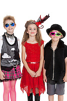 Portrait of school children wearing fancy dress outfits over white background