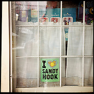 NEWTOWN, CT-10 December 2013-A sign decorates a shop window in the Sandy Hook section of Newtown.  (Photo by Robert Falcetti)