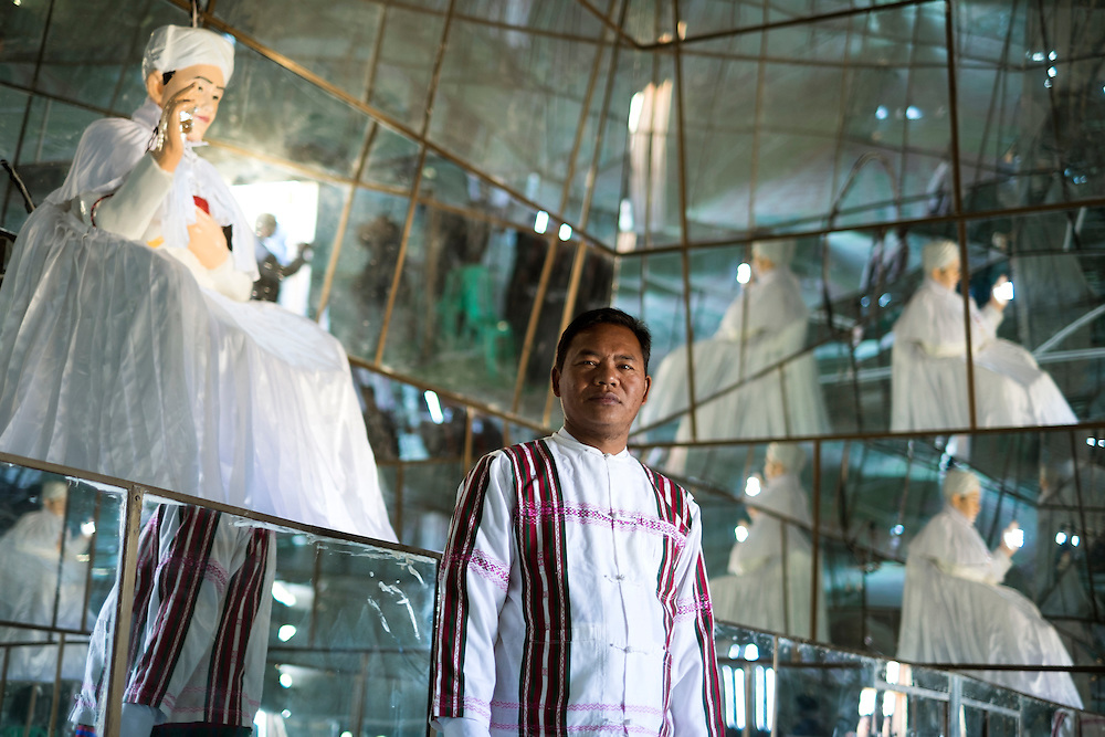 The prophet inside the mirror made temple in Tedim village.<br /> They believe in a supreme God called Pasian and a prophet called Pa Kam Suan Mang who is alive and lead the cult from a Siangswan village in Tedim township.