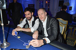 Left to right, JEAN-BERNARD FERNANDEZ VERSINI and JEAN-DAVID MALAT at the Quintessentially Foundation's Poker Night held at The Savoy, London on 13th October 2016.