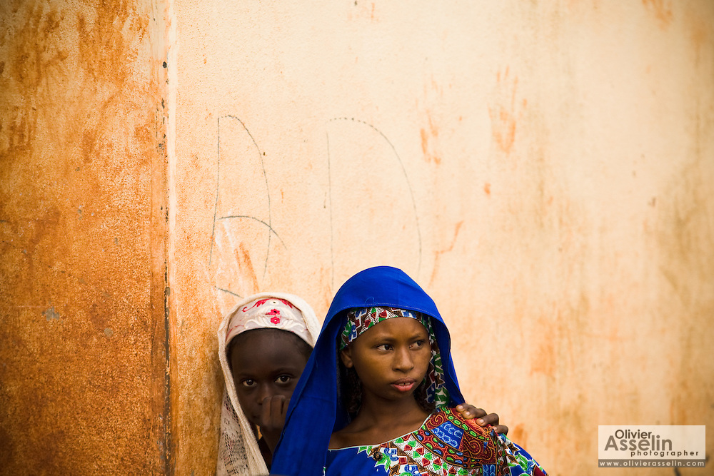 Young girls stand by a wall outside the Bazzama primary school in the town of Bazzama, Cameroon on Wednesday September 16, 2009.  The school integrates the children of refugees from Central African Republic with residents from the area..