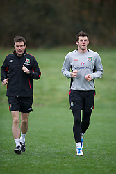 CARDIFF, WALES - Monday, March 21, 2011: Wales' Gareth Bale and physiotherapist Dyfri Owen during a training session at the Vale of Glamorgan ahead of the UEFA Euro 2012 qualifying Group G match against England. (Photo by David Rawcliffe/Propaganda)