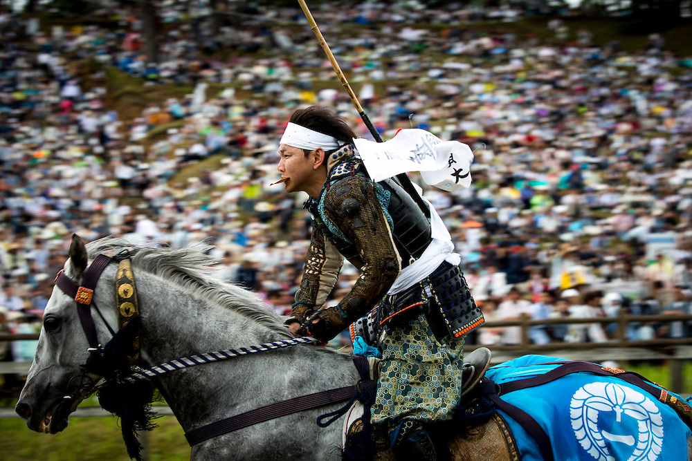 "MINAMISOMA, JAPAN - JULY 24 :  A young samurai horseman is seen after completing the race in the Kacchu-keiba (armed horse race) during the Soma Nomaoi festival at Hibarigahara field on Sunday, July 24, 2016 in Minamisoma, Japan. ""Soma-Nomaoi"" is a traditional festival that recreates a samurai battle scene from more than 1,000 years ago. (Photo: Richard Atrero de Guzman/NURPhoto)"