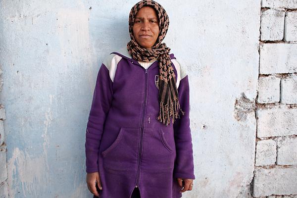 """Kadija has 28 years old, and works as a prostitute in Tamsult, an abandoned souk known by all as the crossroads for sex, which has no more business, only walled boutiques. This desolated place links various villages in an area of the Anti-Atlas mountains. While working Kadija leaves Bham, his son, 6 years, in the next room. """"I do not know the future I could offer him, we are whores, there's no other way out""""..January 2010, Tamsult, Anti-Atlas mountains, Morocco.....The misery of a square bare, dirt, dotted with broken glass and cans, brick structures close the doors of old shops, stray dogs and the ghosts of women who inhabit it. Are Taidit, are """"bitches"""", are prostitutes and are the renters of an old souk abandoned at 1200 meters in the heart of the Anti-Atlas Mountains of Morocco. The time when the market was full of merchants and sellers gave place to the vendors of their own bodies...To protect the identities of the recorded subjects names are fictional."""