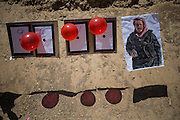 Targets used for the training, balloons and a image representing an Arab man wearing a Kefia.