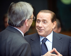 Silvio Berlusconi, Italy's prime minister, right, speaks with Jean-Claude Juncker, Luxembourg's prime minister, during the European Summit, Thursday, June 18, in Brussels, Belgium. (Photo © Jock Fistick)