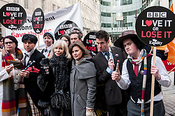 "© Licensed to London News Pictures. 23/11/2015. LONDON, UK. Former Doctor Who girls, Katy Manning and Sophie Aldred  (centre), stand with fans of Doctor Who known as ""Whovians"" and other supporters of the BBC gathered outside Broadcasting House in central London to oppose the threat of 20% government cuts to the Corporation. Photo credit : Stephen Chung/LNP"
