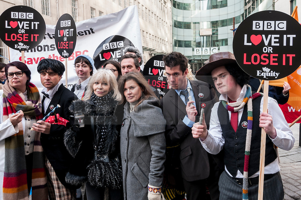 """© Licensed to London News Pictures. 23/11/2015. LONDON, UK. Former Doctor Who girls, Katy Manning and Sophie Aldred  (centre), stand with fans of Doctor Who known as """"Whovians"""" and other supporters of the BBC gathered outside Broadcasting House in central London to oppose the threat of 20% government cuts to the Corporation. Photo credit : Stephen Chung/LNP"""