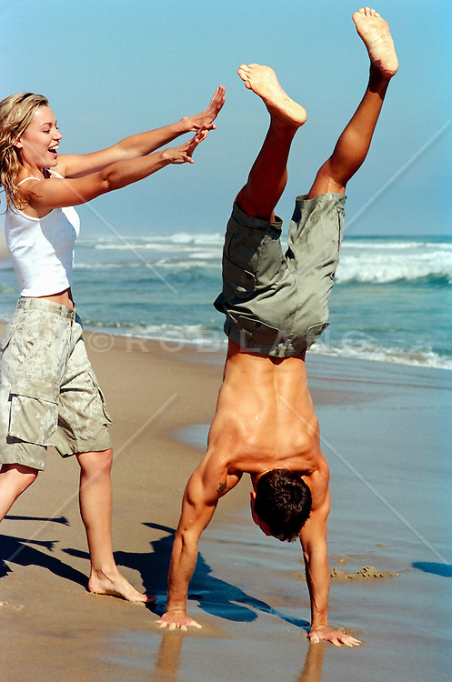 playful couple on the beach in The Hamptons