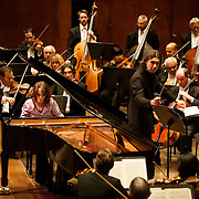"March 11, 2013 - New York, NY : .The London Philharmonic Orchestra lead by conductor Vladimir Jurowski, standing at center right, with piano soloist Hélène Grimaud, performs Ludwig van Beethoven's Piano Concerto No. 4 in G major (1804-07), as part of Lincoln Center's ""Great Performers"" series at Avery Fisher Hall on Monday evening..CREDIT: Karsten Moran for The New York Times"