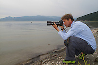 Nature photographer David Maitland photographing on the shore of Lake Macro Prespa (850m) <br /> Galicica National Park, Stenje region, Macedonia, June 2009<br /> Mission: Macedonia, Lake Macro Prespa /  Lake Ohrid, Transnational Park<br /> David Maitland / Wild Wonders of Europe
