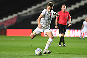 Milton Keynes Dons defender Callum Brittain (25) takes a shot at goal during the EFL Trophy match between Milton Keynes Dons and Wycombe Wanderers at stadium:mk, Milton Keynes, England on 12 November 2019.