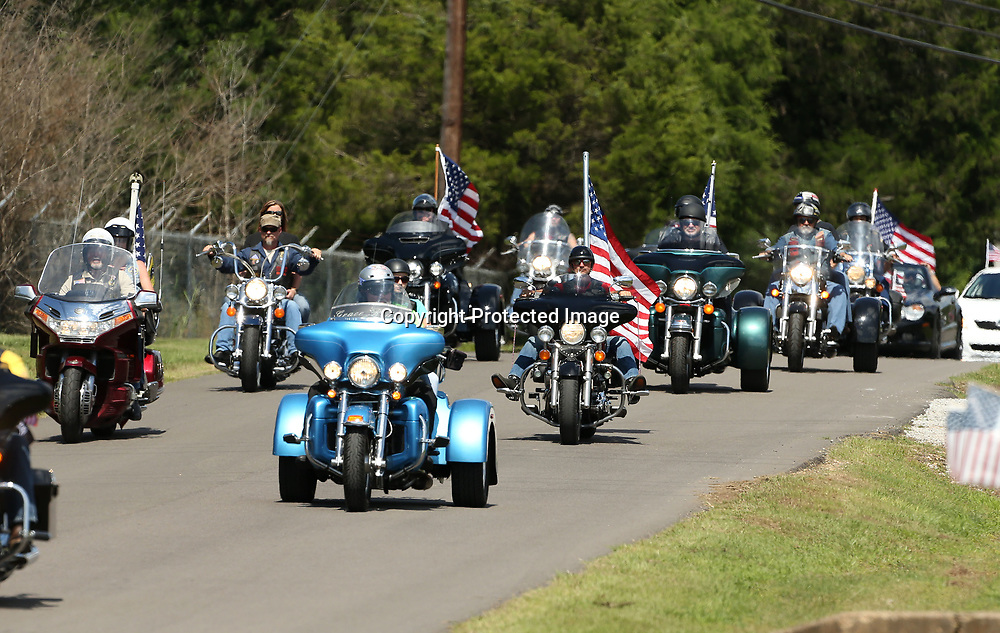 The Patriot Guard Riders arrive for the graveside service to honor the late Sergeant Kyle Thomas at Haughton Memorial Park in Amory Friday afternoon.