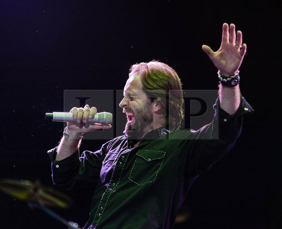 "© Licensed to London News Pictures. 16/09/2012. London, UK.  Alfie Boe performs at The Sunflower Jam at the Royal Albert Hall.  The Sunflower Jam is a British charity, founded by Jacky Paice, wife of Deep Purple drummer, Ian Paice. Other high-profile supporters are the actor Jeremy Irons, ex-Jamiroquai bassist Nick Fyffe and Charles, Prince of Wales. The aims of the charity are to fund complementary therapists and spiritual healers to work on cancer wards in the British National Health Service. After setting up a meeting between members of Deep Purple and a young boy dying of leukemia, Paice saw ""all the good work the healers were doing"" and decided ""lets find a way to raise money to get more healers in there. Alfie Boe has just taken on the lead role of Jean Valijean in the 25th anniversary concert of Les Miserables.  Photo credit : Richard Isaac/LNP"