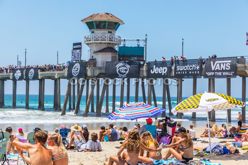 People Sitting on the Beach During the Vans US Open of Surfing Competition in Huntington Beach