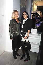 Left to right, MAIA NORMAN wife of Damien Hirst and HANNAH BHUIYA at a party hosted by Kate Sumner at Zadig & Voltaire to celebrate the brand's arrival in London at 182 Westbourne Grove, London W11 on 14th October 2008.