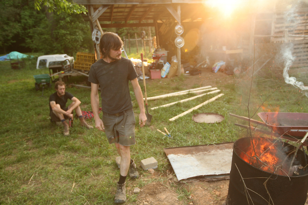 Pittsboro, NC - May 13: Noel and Grey work at making bio-char at  the farm at Circle Acres. (Photo by Logan Mock-Bunting)