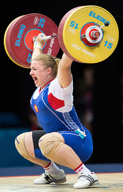 Tatiana Kashirina of Russia breaks a world record with a lift of 151kg in the women's +75kg at the ExCeL centre during the 2012 Summer Olympic Games in London, England, Sunday, August 5, 2012. Kashirina won the silver medal in the event. (David Eulitt/Kansas City Star/MCT)