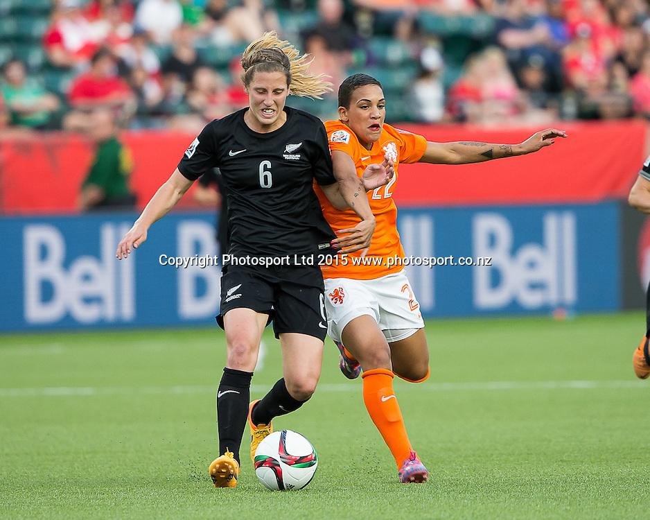 Shanice Van De Sanden, Rebekah Stott. Edmonton, Alberta, Canada, June 6, 2015.  The opening day of the Women's World Cup at Commonwealth Stadium.  New Zealand was defeated by Netherlands 1-0.